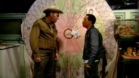 Rex and Sheriff Lou marvel at the Wheel O' Revenge.