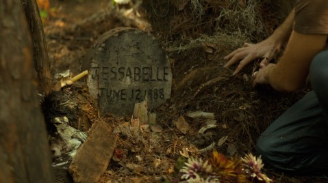 A grave marked with Jessabelle's birthday.