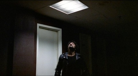 A raider (Tom Savini) sees Peter's escape route.