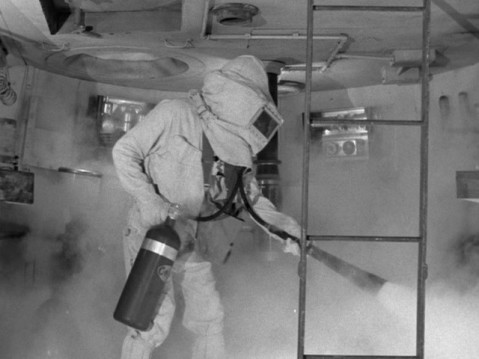 It's not a 1950s space movie until someone has to put out a fire.