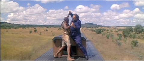 Umbopo fights a Notzi atop the train.